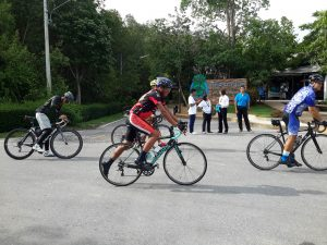 Enthusiasts cycling the 850 meter track along the mangroves