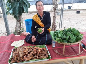 Fresh seafood served by a Thai song Dam lady