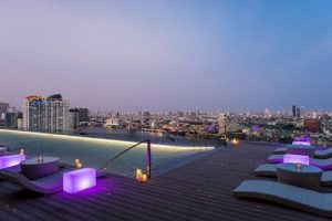 Infinity pool at sunset at AVANI Riverside Bangkok - low res