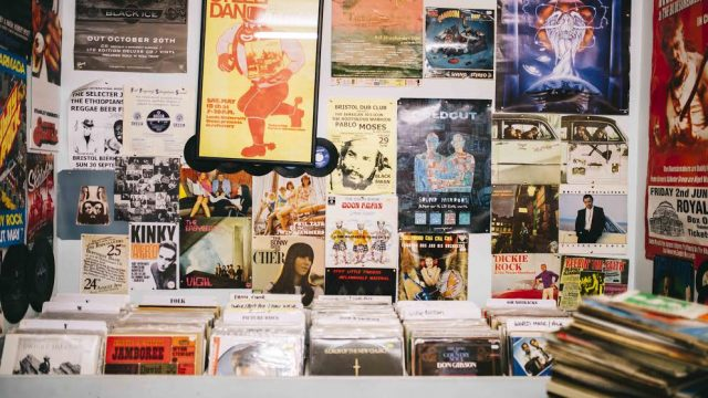 Record Shop. Pop music posters, advertising bands, stuck on to the walls of a shop selling vinyl records.